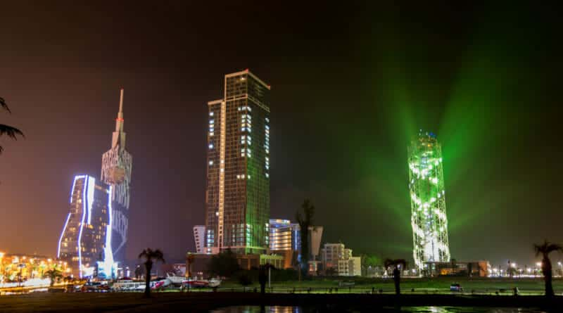 Skyline of Batumi in pouring rain by night.